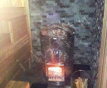 Баня: деревянные элементы из красного канадского кедра, печь Narvi, плитка - галькохлорит рваный камень - фото