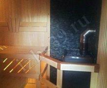 Сауна с липовой отделкой, плитка под камень, печь Castor фото